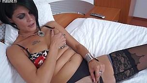Horny older slut masturbating on her ottoman